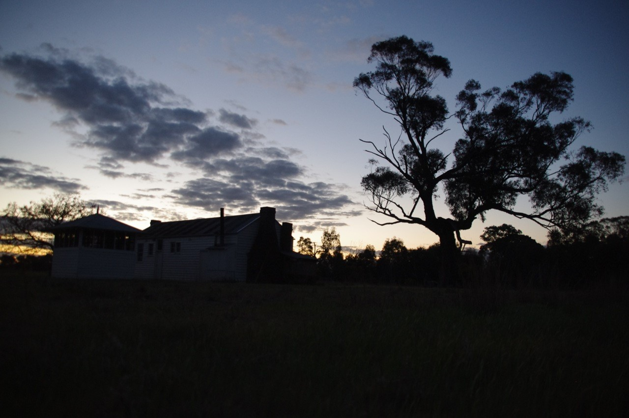 thumbnail_Hut and outhouses sunset Sept_